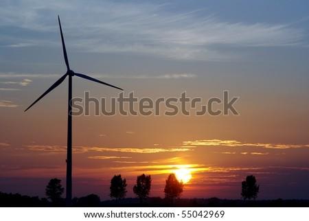 wind turbine on sunset background