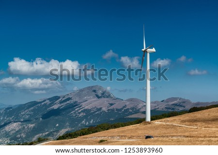 Wind turbine on the top of a mountain in Nothern Italy. Clean enviroment friendly energy. #1253893960