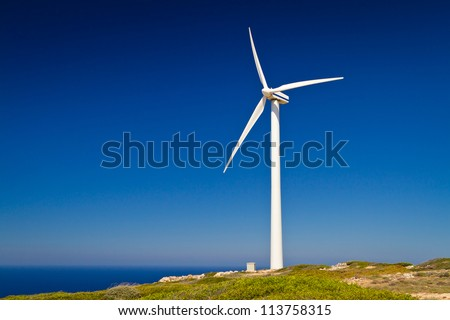 Wind turbine over blue sky on Crete, Greece