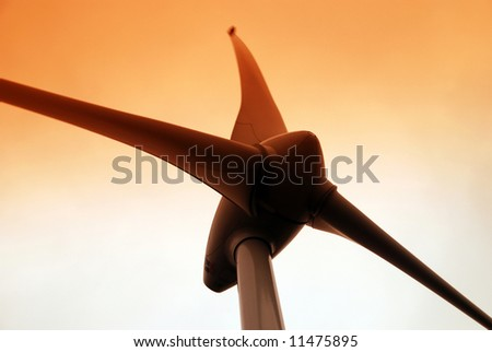 Wind turbine propeller and a sunset sky