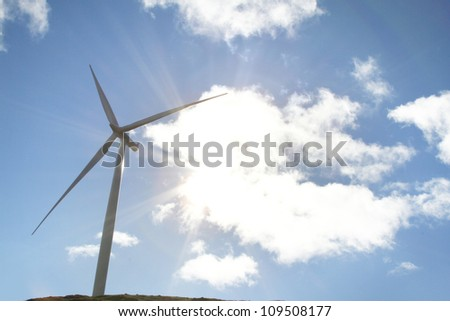 Wind turbine, sunshine and clouds