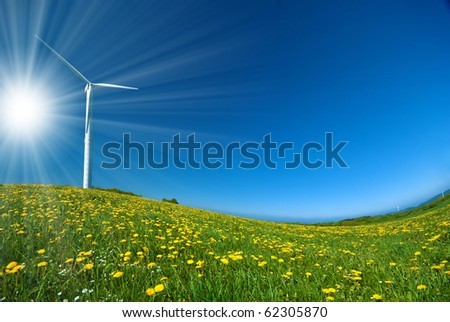 Wind turbine under blue sky