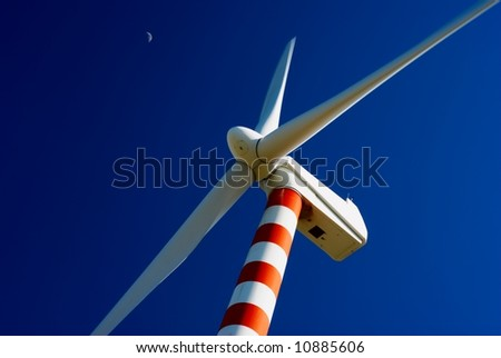 Wind turbine with deep blue sky and moon