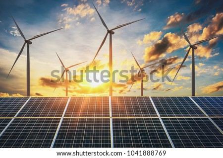 wind turbine with solar panels and sunset. concept clean energy Photo stock ©