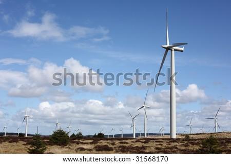 Wind turbines against blue sky and cloudscape