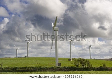 Wind turbines against the cloudy sky in Cornwall, UK.