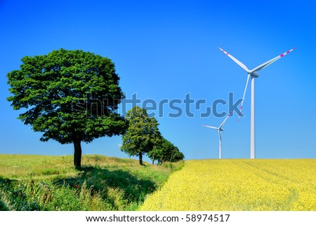 wind turbines and trees, cloudless sky in background