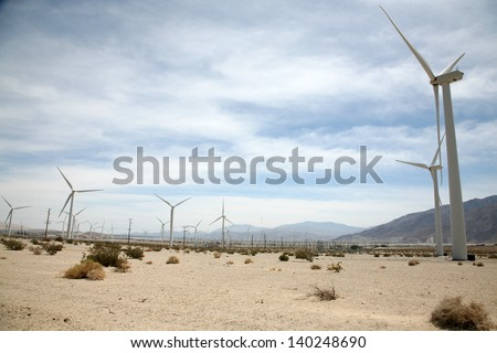 Wind Turbines at a Wind Farm in Southern California by Palm Springs produce Green Energy and help to power the homes and businesses of Palm Springs, Palm Desert, and surrounding cities.
