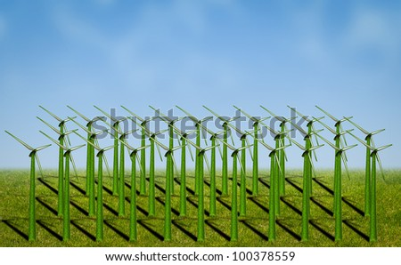 wind turbines covered with grass in a field - stock photo