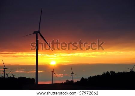 Wind turbines during beautiful sunset