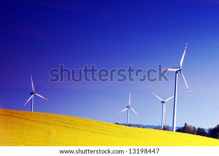 Wind turbines. Energy. Beautiful meadow - stock photo
