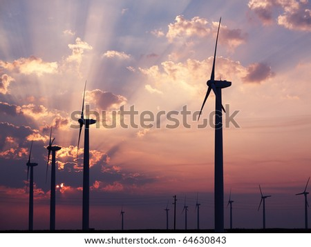 Wind turbines farm. Alternative energy source - stock photo
