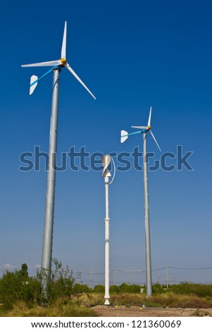 Wind turbines farm and blue sky