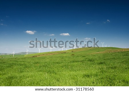 Wind turbines farm on the hills in Wales, UK. Alternative energy source. - stock photo
