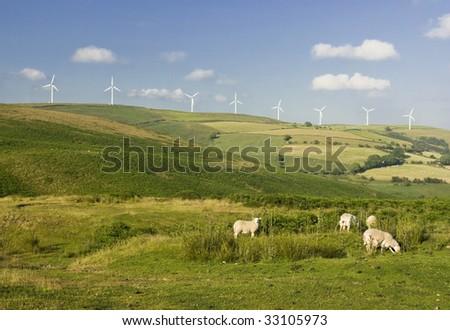 Wind turbines farm on the hills in Wales, UK. Alternative energy source.