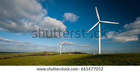 Wind turbines farm on the mountains; blue sky, white clouds. #661677052