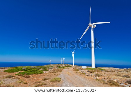Wind turbines field over blue sky on Crete, Greece