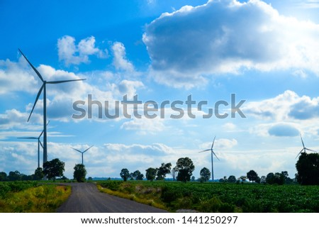 Wind turbines generating electricity with blue sky #1441250297