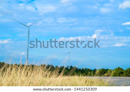 Wind turbines generating electricity with blue sky #1441250309