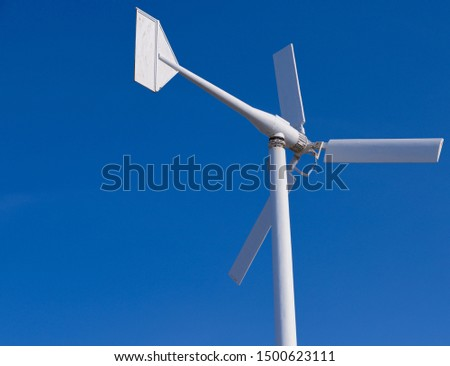 Wind turbines generating electricity with blue sky - energy conservation concept - Image  #1500623111