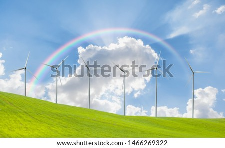 Wind turbines generating electricity with rainbow #1466269322