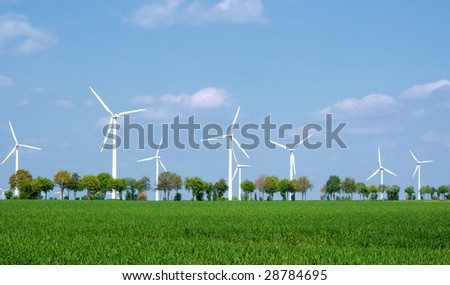 Wind turbines in a green landscape