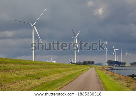 Wind turbines in a line along the shore Stockfoto ©