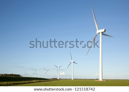 wind turbines in a row in the Dutch province of Flevoland