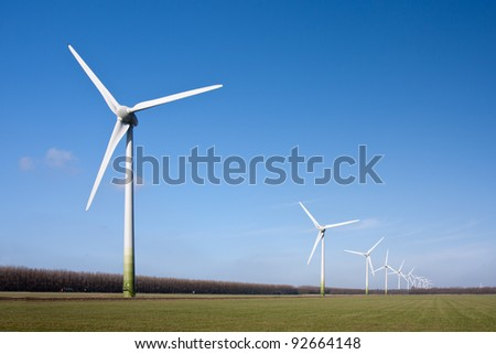 Wind turbines in the farmland of Flevoland, the Netherlands