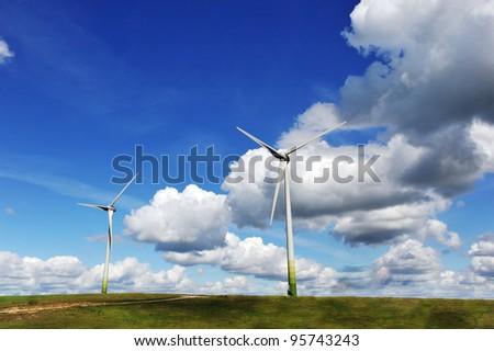 wind turbines in the fields under blue sky
