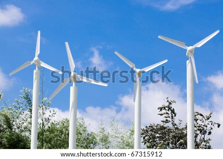 Wind Turbines in the with blue cloudy sky