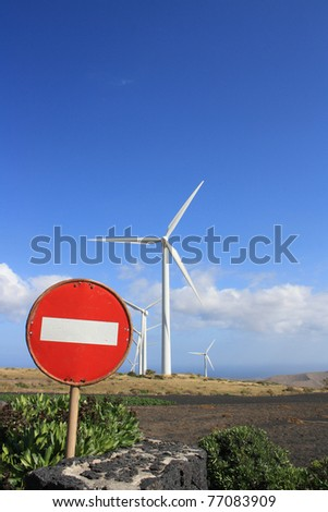 Wind turbines near a road sign for forbidden traffic (Lanzarote Canary Islands)