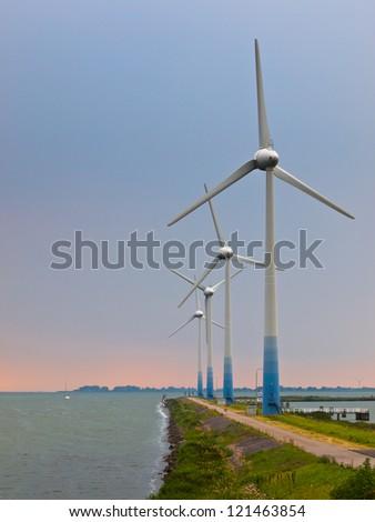 Wind Turbines on a pier at IJsselmeer in the Netherlands
