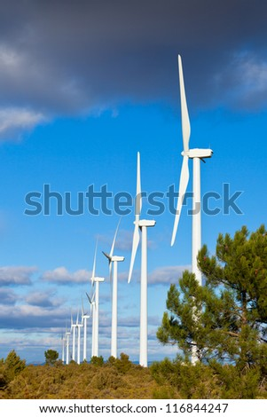 Wind turbines on a wild field in Spain. Vertical shot
