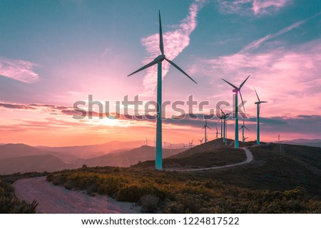 Wind turbines on beautiful sunny summer purple autumn mountain landsape. Curvy road through mountain Eolic park. Green ecological power energy generation. Wind farm eco field #1224817522