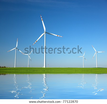 Wind Turbines on green field. Alternative energy, environment concept