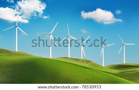Wind turbines on green spring hills of California. Altamont Pass wind farm near Livermore.
