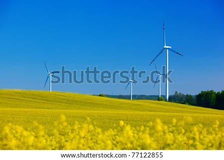 Wind Turbines on spring field. Alternative energy, environment concept