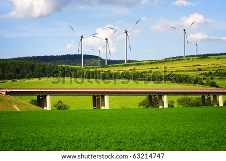 Wind turbines over the highway