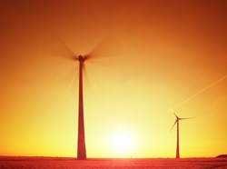 Wind Turbines Producing Electric Energy within  sunny spring morning. Vintage Style Toned effect