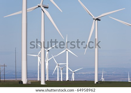 Wind turbines sprout out of wheat fields in south east Washington State, USA.