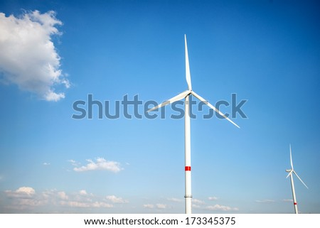 Wind turbines standing against bright blue sky Stock photo ©