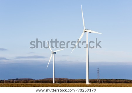 Wind turbines / Two turbines on a wind farm and blue sky