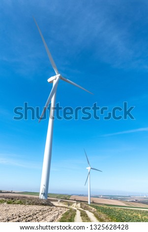 Wind turbines.Wind turbines generating electricity with blue sky energy conservation concept. #1325628428