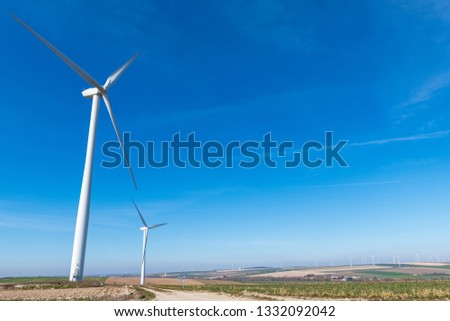 Wind turbines.Wind turbines generating electricity with blue sky energy conservation concept. #1332092042