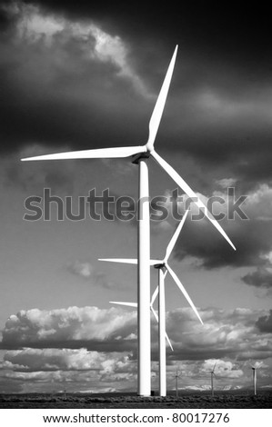 Wind Turbines with a cloudy sky in black and white