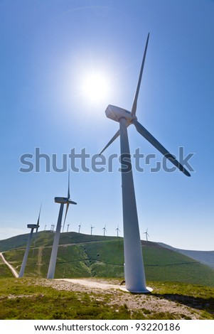 Wind turbines with more behind, vertical shot, copy space - stock photo