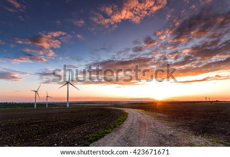 Wind turbines with power line in the sunset!