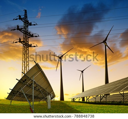 Wind turbines with solar energy panel and electricity transmission pylon on field against the sunset. Sustainable resources concept.