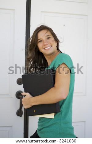 Windblown college female going into class, slight motion blur